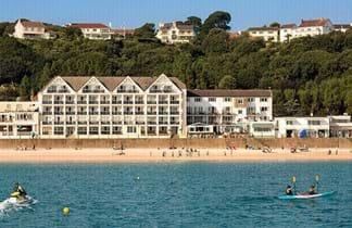 golden sands and blue sea at st brelade's bay hotel in jersey