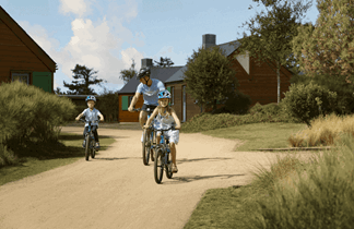 two boys cycling around les ormes resort in jersey