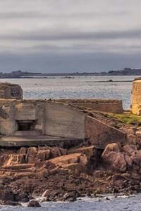 view of fort hommet in guernsey with sea in background
