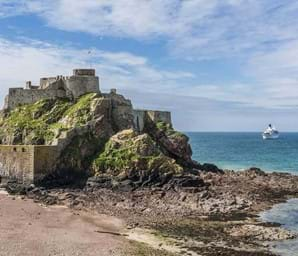 elizabeth castle in jersey with blue sea in background