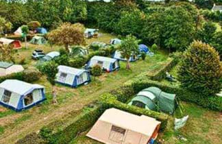 green fields and tents in fauxquets valley campsite in guernsey