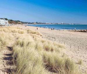 white sand and blue sea at sandbanks beach in dorset uk