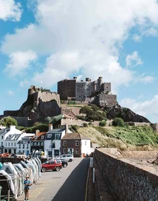 mont orgueil castle jersey blue skies ships in the sea