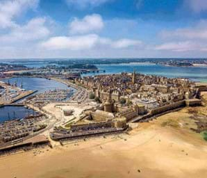 view looking over st malo brittany with blue sky and blue sea