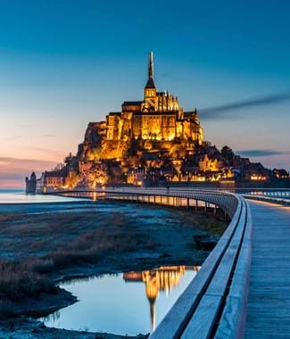 mont st michael in normandy with dark lit sky