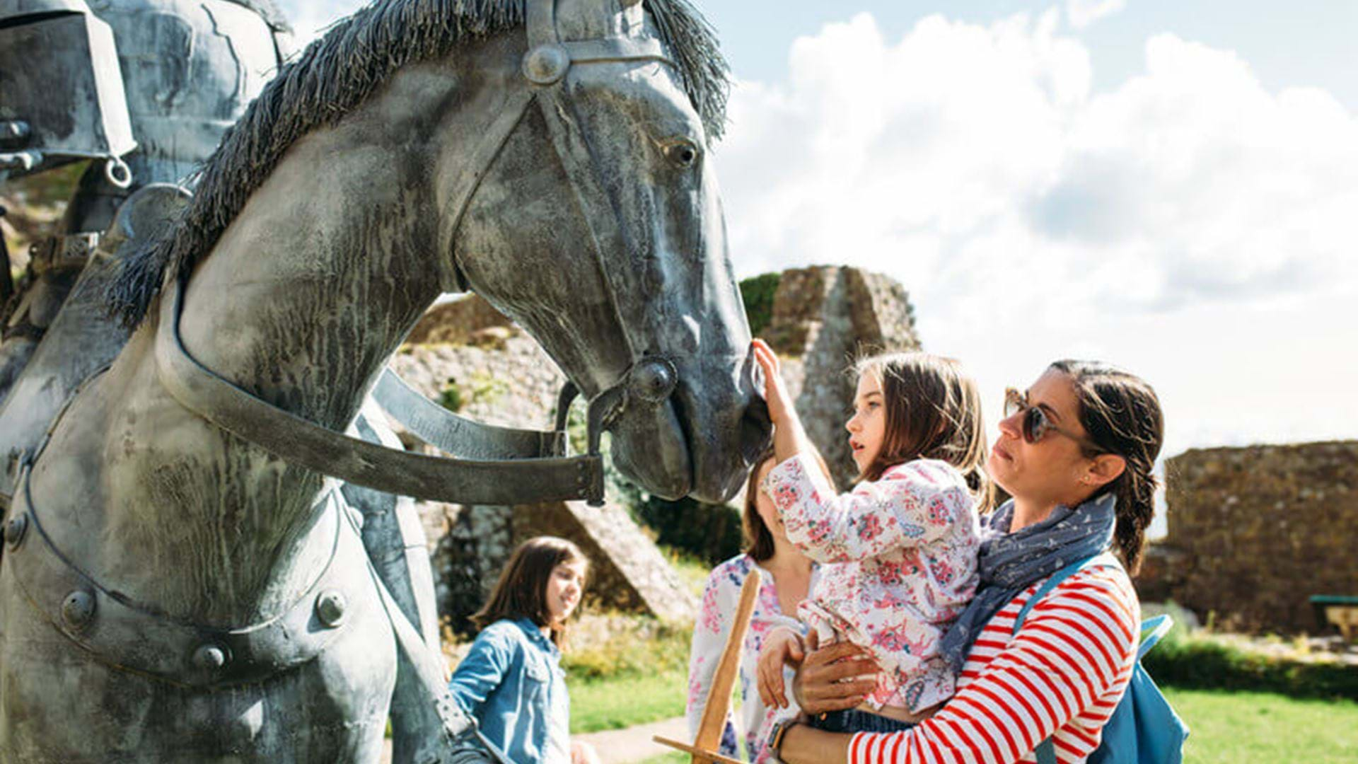 children-looking-at-horse-statue-mont-orgueil-jersey-channel-island