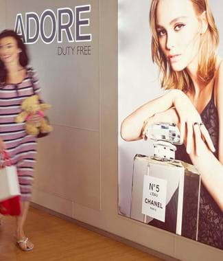 couple walking past adore duty free condor