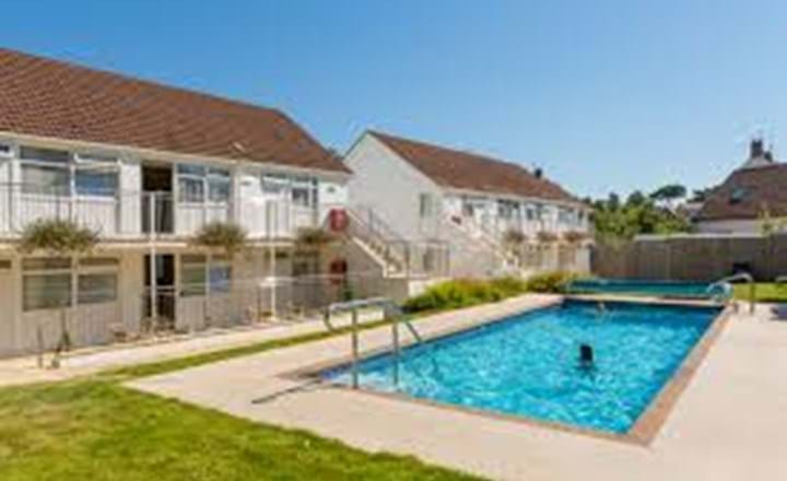 outdoor swimming pool at ilex lodge in guernsey channel islands