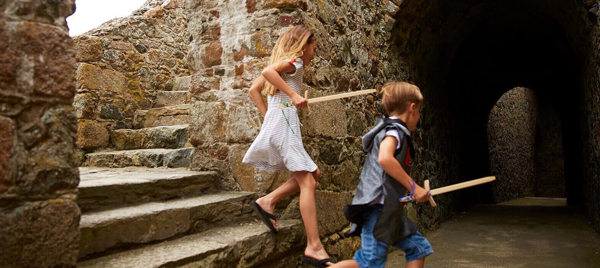 two children playing at castle cornet in guernsey