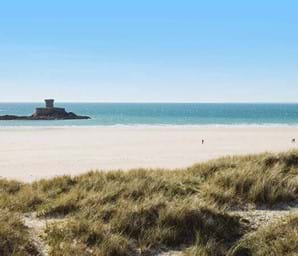 st ouen's bay in jersey with white sand and blue sea