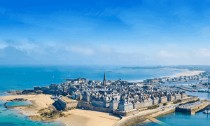 Get a ferry to St Malo & see historic walls in brittany with blue sky and golden sands