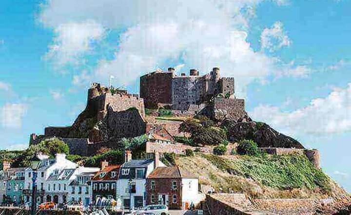 Mont Orgueil Castle Jersey with cars and boats infront
