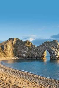 durdle door dorset with blue sea and golden sands