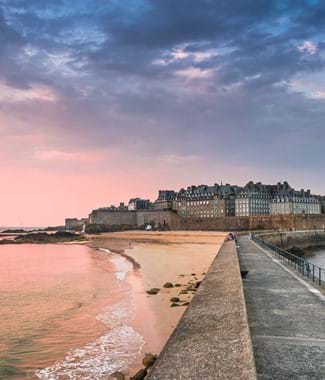 view of st malo walls in brittany with pink sky