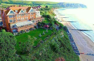 grand hotel in swanage on clifftop looking over blue sea
