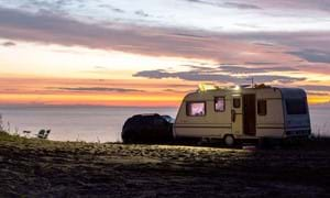 campervan looking over countryside in guernsey channel islands with pink sky
